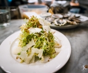 Frisee salad with anchovy cream, crispy quinoa and pecorino - The Walrus and The Carpenter, Seattle, Washington